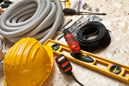 osb: electrician tools on osb wood background