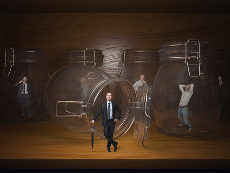 proble: 3d glass jail and business people prisoners Stock Photo