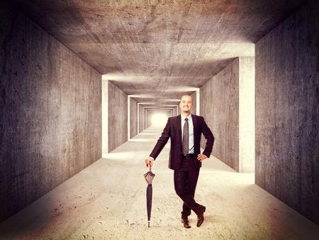 futuristic interior: smiling man and concrete tunnel