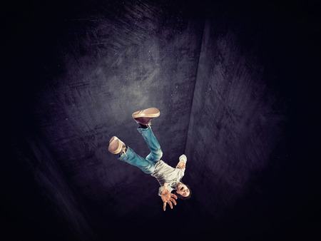 falling man: falling man and vertical tunnel 3d Stock Photo