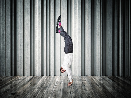 ability: acrobat businessman and abstract background Stock Photo