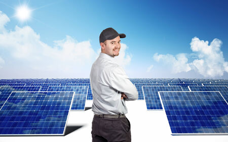module: smiling worker and photovoltaic module Stock Photo