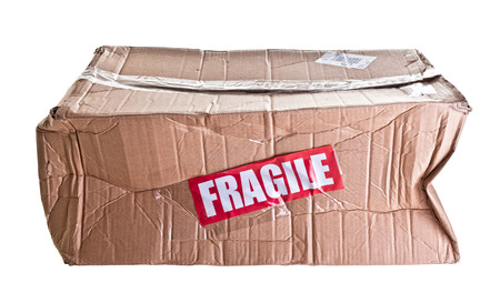 damaged: damaged cardboard parcel on white background
