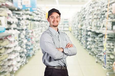 smiling worker in big sport shop