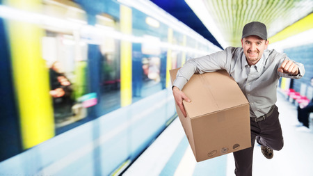 running delivery man with parcel Stock Photo