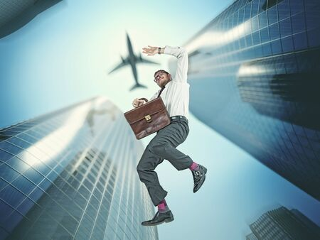 3d weird: falling businessman and skyscraper background Stock Photo