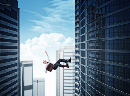 man falling: skyscaper background and falling business man