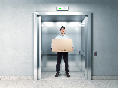 people in elevator: delivery man and elevator background