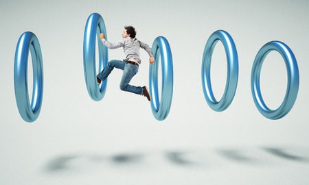 caucasian man: caucasian man jump inside of 3d ring