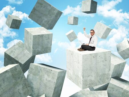 proble: smiling businessman on 3d concrete abstract cubes Stock Photo