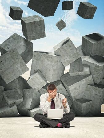 falling cubes: sit businessman and falling concrete cubes