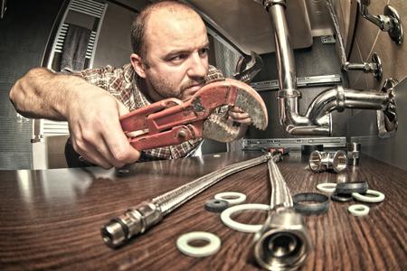 indoor shot: plumber at work indoor shot