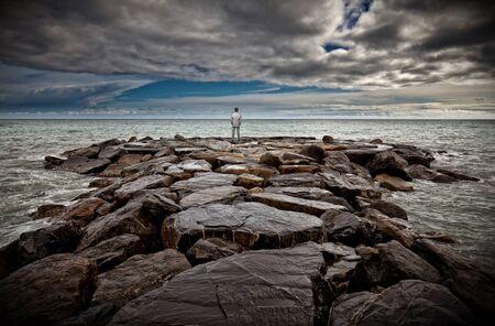 splash back: standing businessman on sea rock