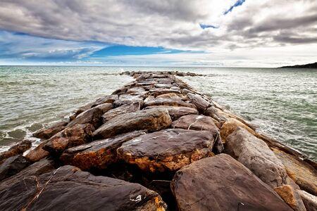 storm tide: rocks reaf and sea background