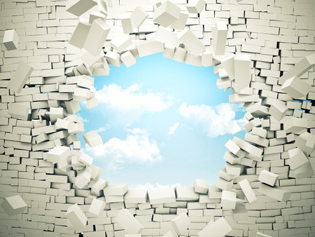 breaking wall and blue sky with clouds