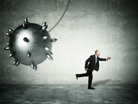 ball and chain: running man and iron ball Stock Photo
