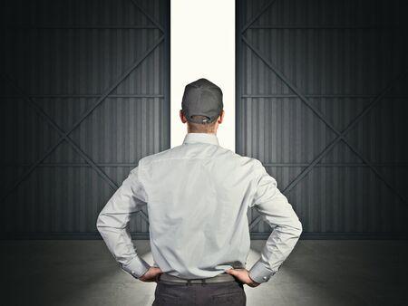 empty warehouse: 3d image of huge hangar doors and worker