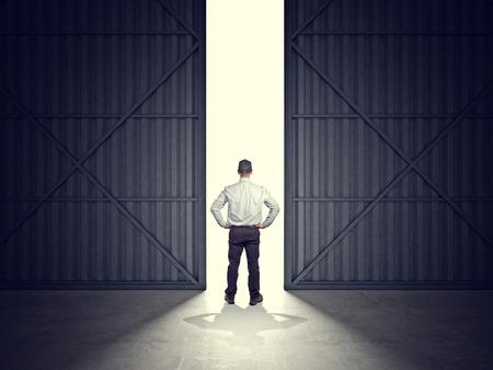 garage doors: 3d image of huge hangar doors and worker