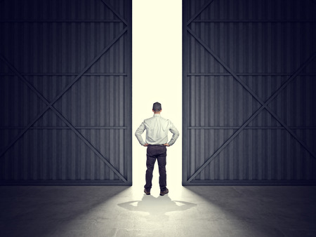 3d image of huge hangar doors and worker