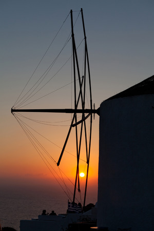 scenary: oia mill at sunset santorini island greece Stock Photo