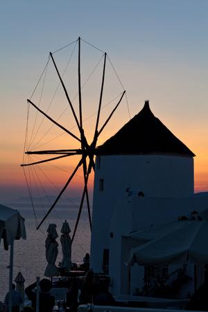 nightview: oia mill at sunset santorini island greece Stock Photo