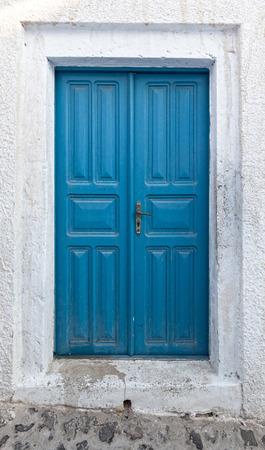 oia: old traditional door in Oia santorini