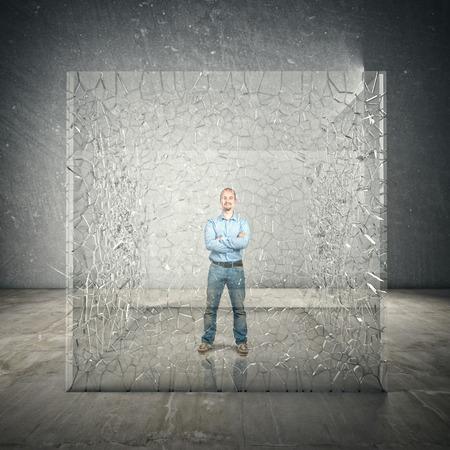 standing man: standing man inside broken glass cube Stock Photo