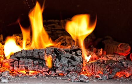 embers: image of fire inside of wood hoven Stock Photo