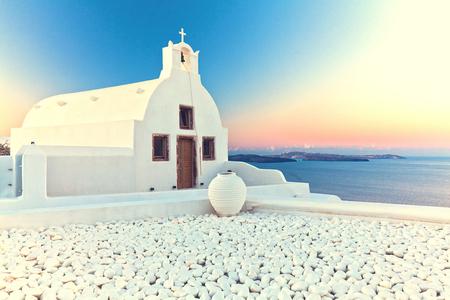 urbanscape: image of oia, Santorini at sunrise