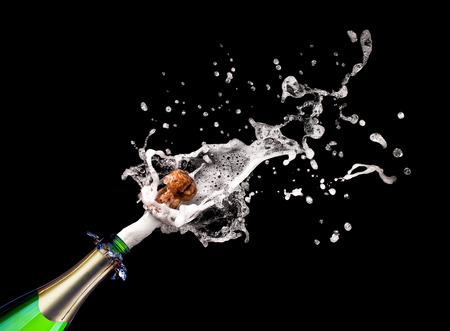 popping cork: detail of popping champagne on black background Stock Photo