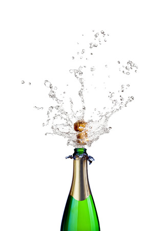 popping cork: detail of popping champagne on white background