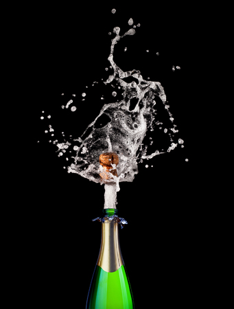 glass bottle: detail of popping champagne on black background Stock Photo
