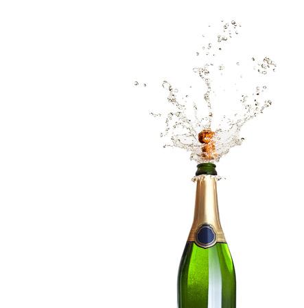 botella champagne: detalle de hacer estallar el champ�n sobre fondo negro Foto de archivo