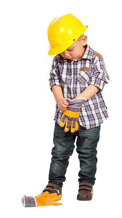 a helmet: cute child act like handyman isolated on white