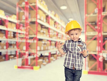 act: cute child act like handymanin warehouse