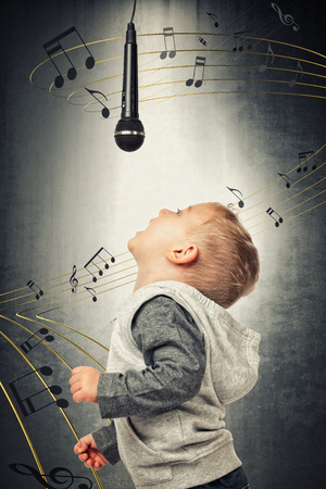 mics: portrait of little singer and 3d abstract music background