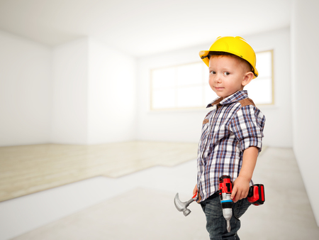little carpenter at construction site Stok Fotoğraf - 46779111