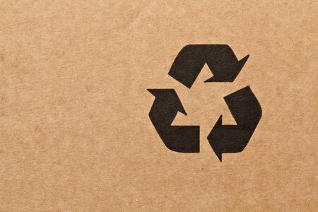 recycling symbols: detail of recycle symbol on cardboard