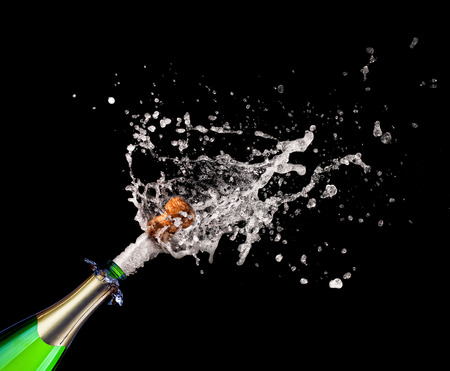 champagne bottle: closeup of popping champagne and splash