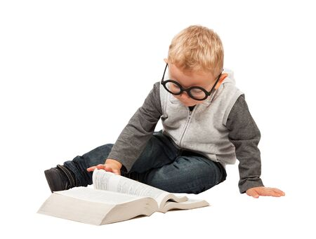 funny glasses: little child try to reading a book with funny glasses