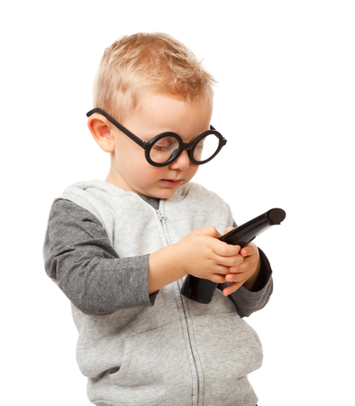 funny glasses: child with remote control and funny glasses Stock Photo