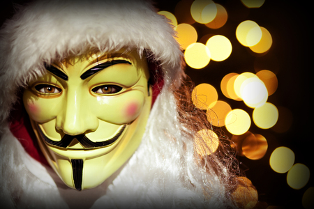 christmas image hacker with mask and santa clothes
