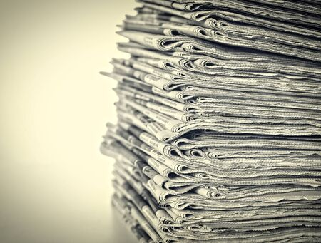 daily: stack of daily newspapers background Stock Photo