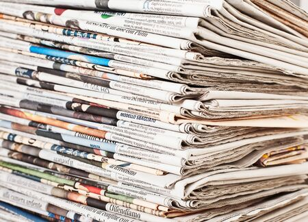 stack of daily newspapers background 写真素材