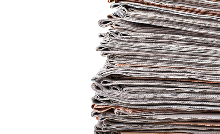 broadsheet: stack of daily newspapers background Stock Photo