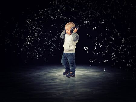 kids background: child with headphone and abstract music background