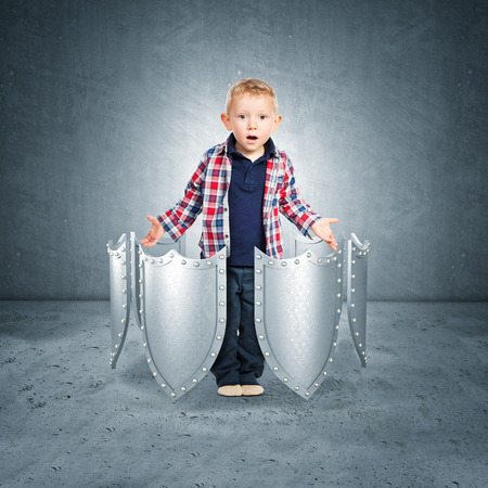 internet security: kid portrait and 3d shield concept