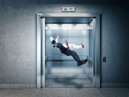 3d scary: businessman falling in modern elevator Stock Photo