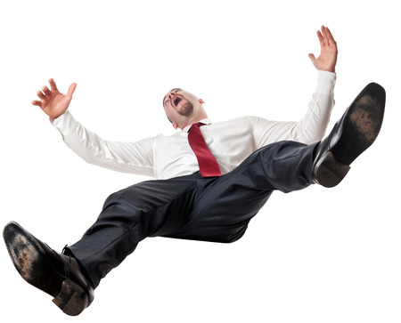 hombre cayendose: Hombre que cae abajo aislado en blanco Foto de archivo