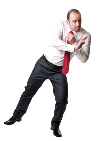 hombre en posición de empuje aislado en blanco Foto de archivo